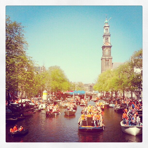 View of the canals and Westertoren in Amsterdam, Queensday 2012